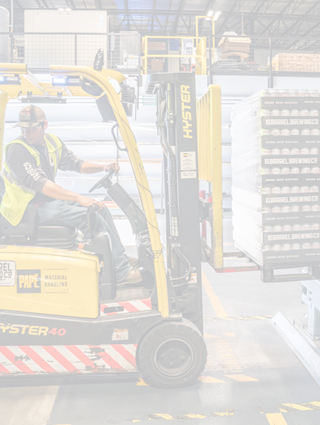 Warehouse forklift moving palettes fade - Photo by Pexels
